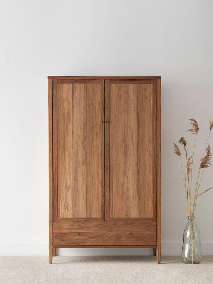 contemporary timber wardrobe with 2 doors and single drawer on low leg with internal rail and shelving