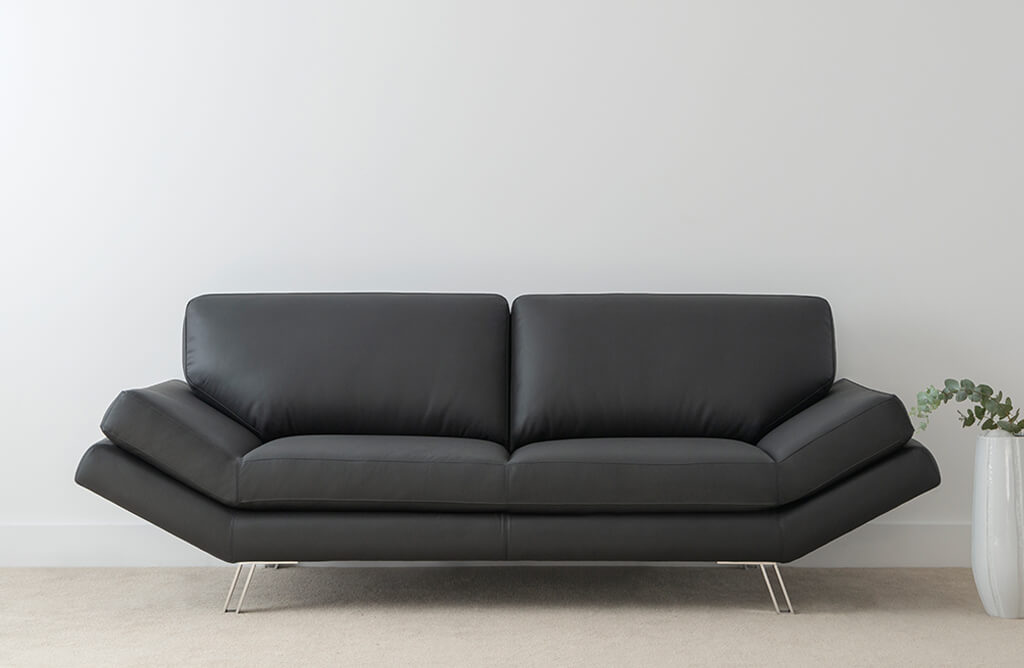 contemporary elegant leather lounge with angled arms and chrome leg feature