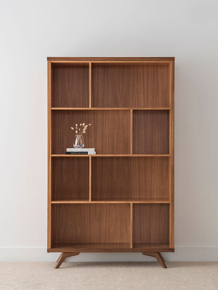 scandinavian design bookcase with abstract shelving and discreet angled legs crafted in tasmanian blackwood timber