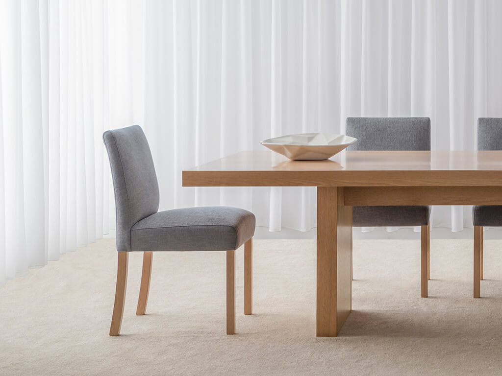 modern dining chairs upholstered in soft blue fabric against mountain ash timber legs made in adelaide
