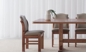 traditional dining chair design with solid timber features and taupe leather seats with arch back detail