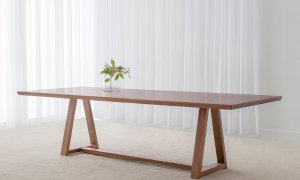 testle base dining table with tapered table top and slim features crafted in blackwood timber