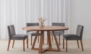 luxurious velvet dining chair with curved back and wide seat with round satin finish dining table on cross leg base