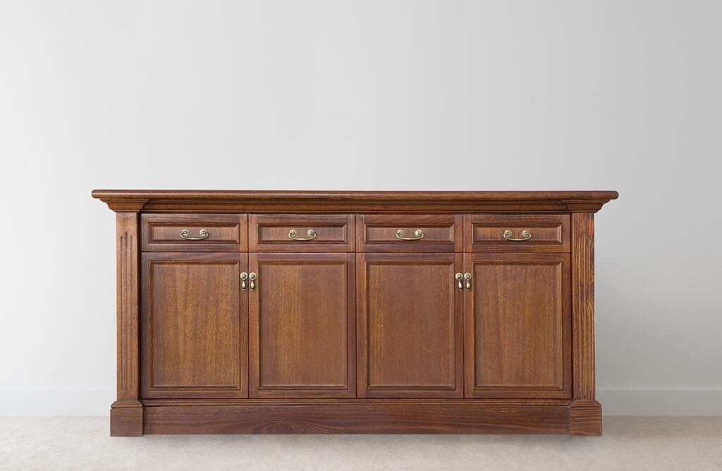 traditional buffet with ornate details and solid timber base plus 4 doors and 4 drawers with drop handles