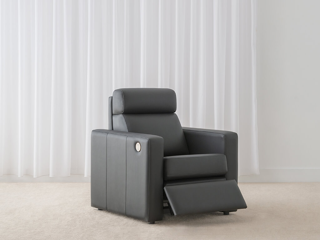 elegant electric recliner in black leather with solid arm and head roll support made in adelaide