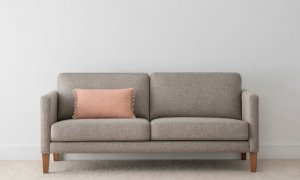 small grey fabric sofa with slim arms and low back on blackwood timber legs