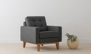 square design fabric armchair with button detail and timber base
