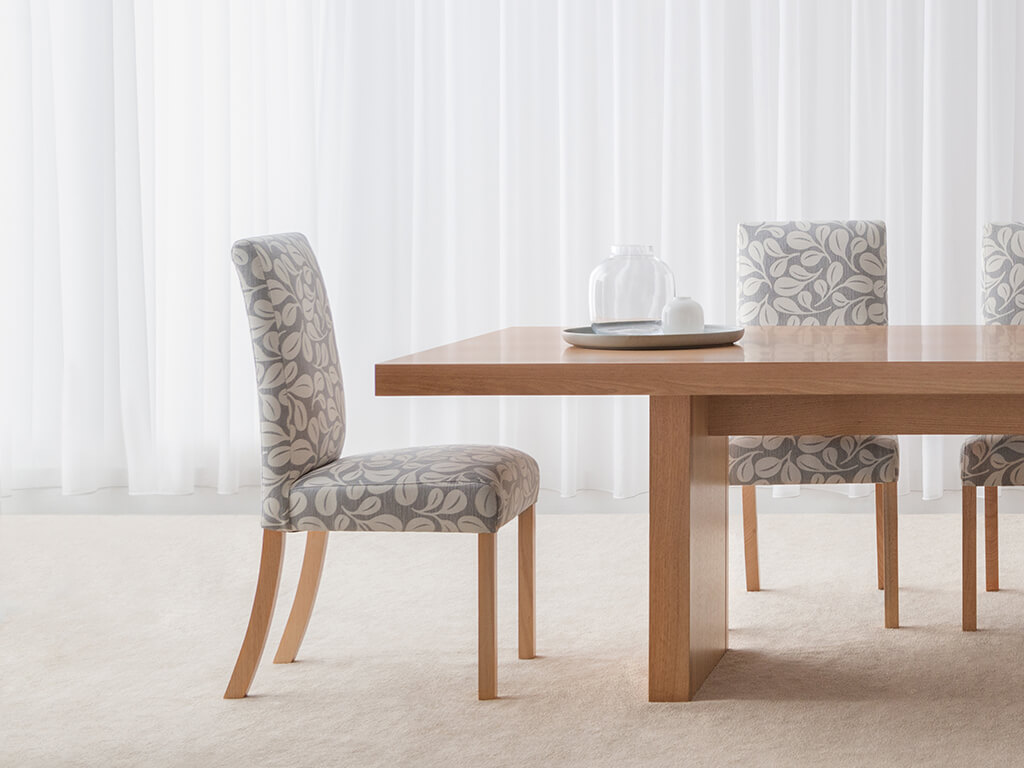 elegant fully upholstered dining chair in soft pattern fabric with mountain ash legs