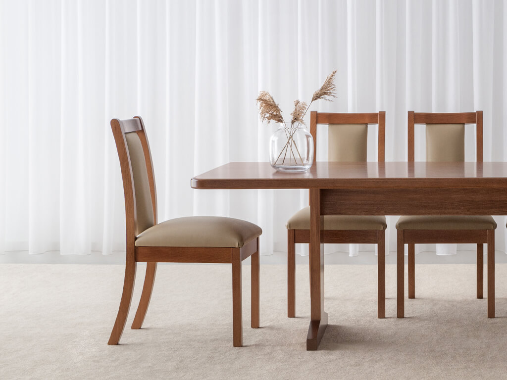 light colour leather upholstered dining chair with timber border and legs in honey tone