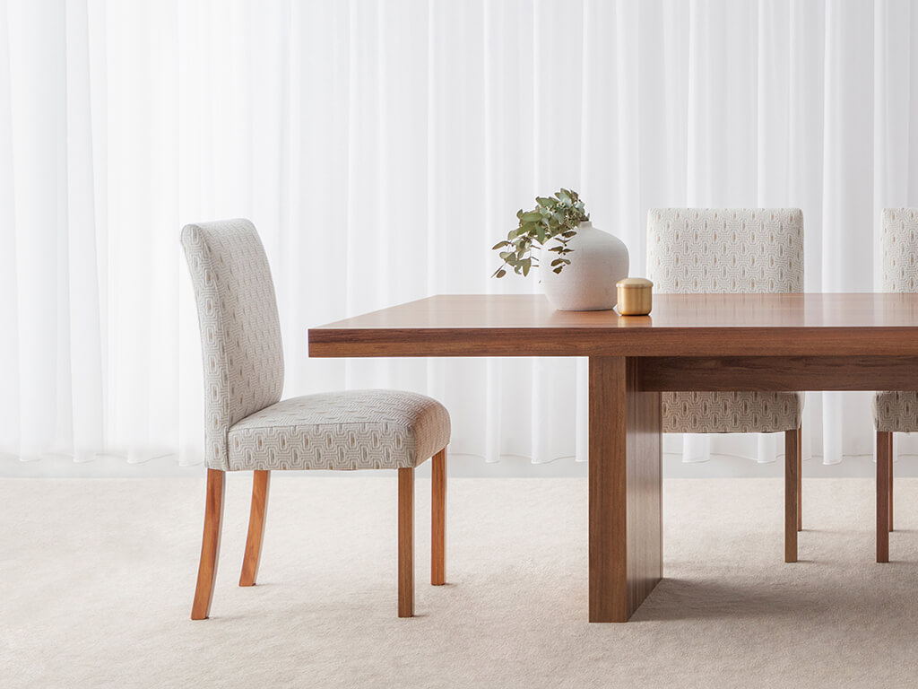 elegant contemporary dining chair in light fabric with high back and sturdy timber frame