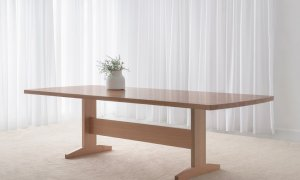 slim hampton style dining table with pedestal base and curved end crafted in mountain ash timber