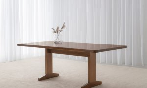 spacious dining table with modern pedestal base and curved corners made in custom tone hardwood timber