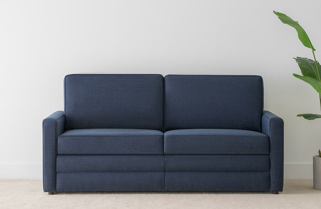 2.5 seater royal blue fabric sofa bed with modern thin arm and square design