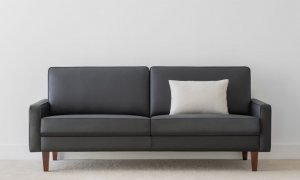 modern 3 seater lounge in black leather with square back and slim arm on high leg