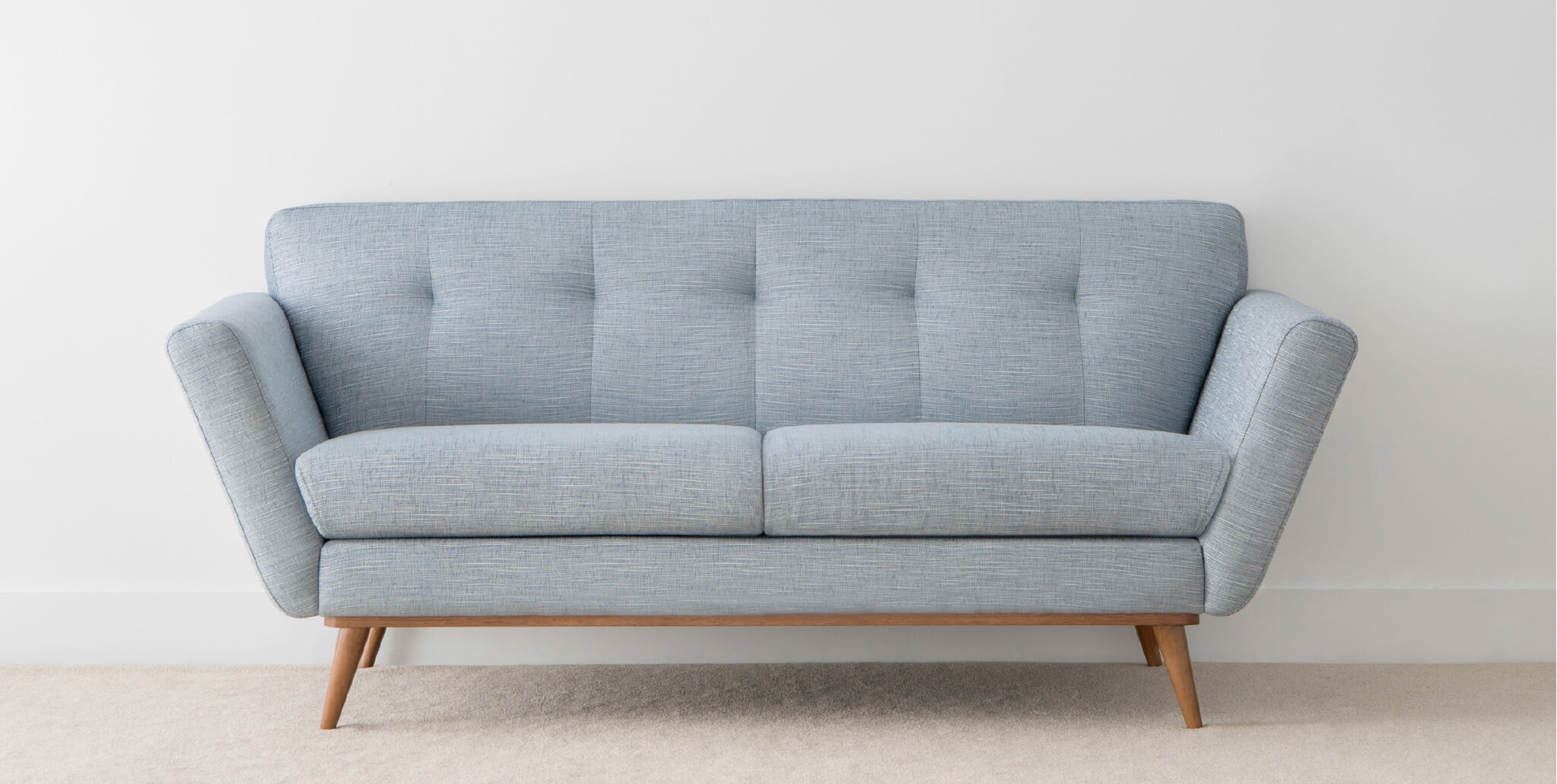 modern designer sofa on timber leg with blue fabric