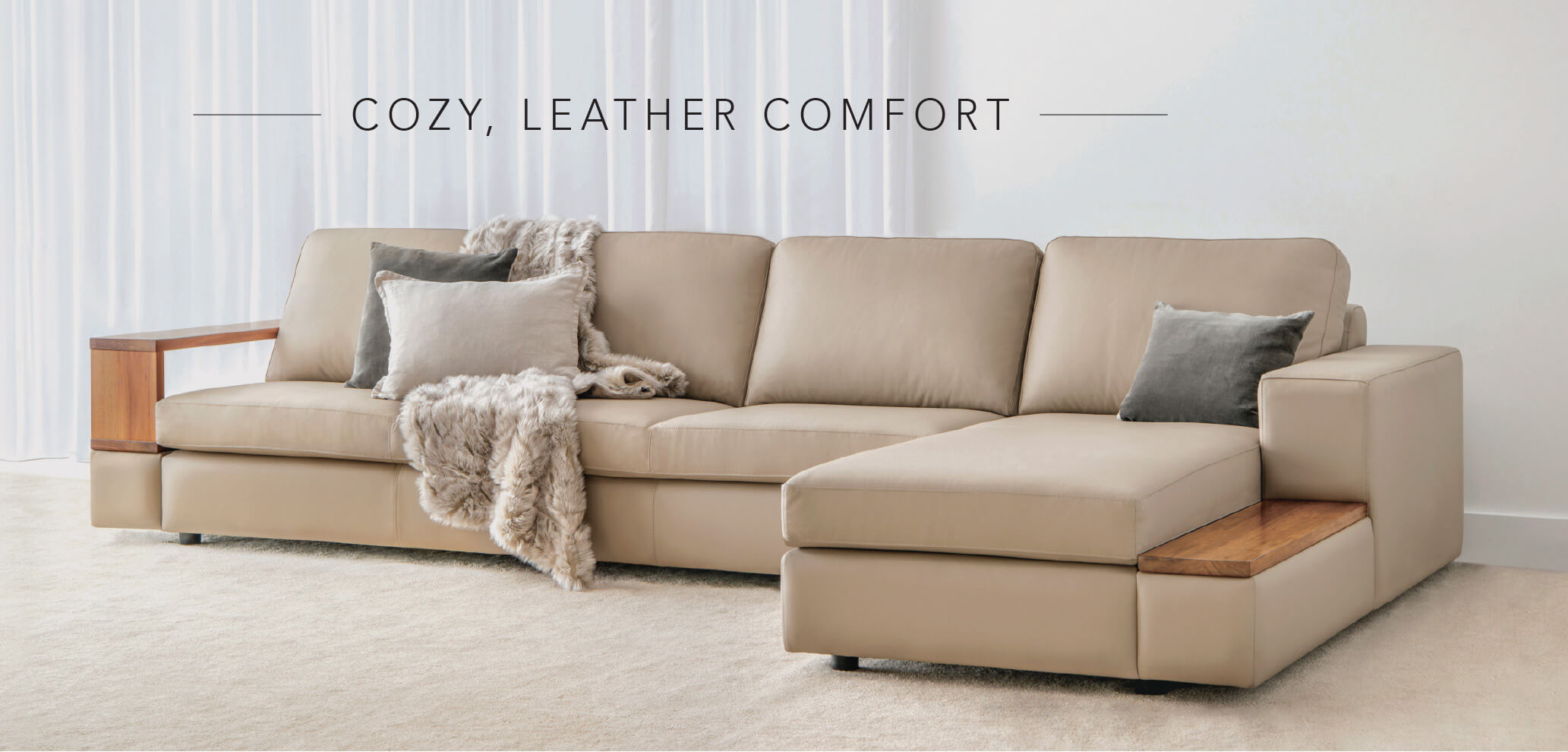 comfortable modular lounge in quality leather with timber arms