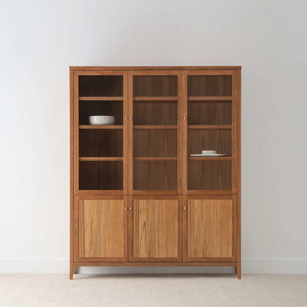 contemporary tasmanian blackwood wallunit with glass doors and timber doors and internal shelving, sitting on tapered leg