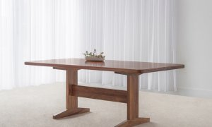 solid timber dining table made in Blackwood with rounded corners and traditional pedestal base and foot rail