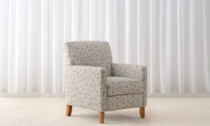 simple arm chair in floral pattern fabric with timber legs