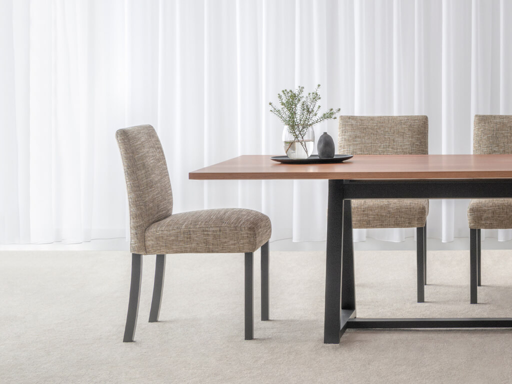 fabric upholstered dining chair with textured finish and black legs