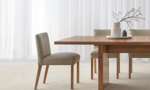 leather dining chair with low back and curved back support in pebble colour with timber legs