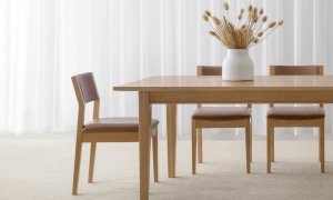 tan leather dining chair with timber frame and exposed back panel