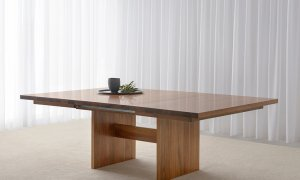 large timber extendable dining table with grain feature on panel base