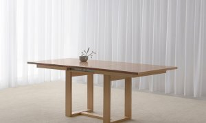 small extendable dining table with tapered top and open end base