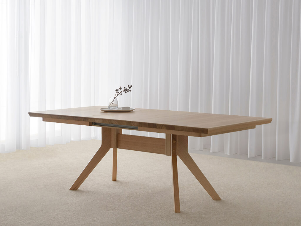 large extendable dining table made in Adelaide from mountain ash timber on angled legs with tapered table top