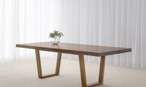 solid timber dining table with walnut tone and angular base