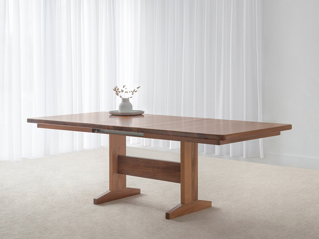 tasmanian blackwood extendable dining table with rounded corners and pedestal base