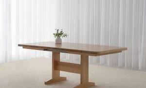extendable dining table made in Adelaide from mountain ash timber with soft corners and a pedestal base