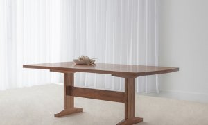 large dining table made in Adelaide with blackwood timber on pedestal base with curved ends