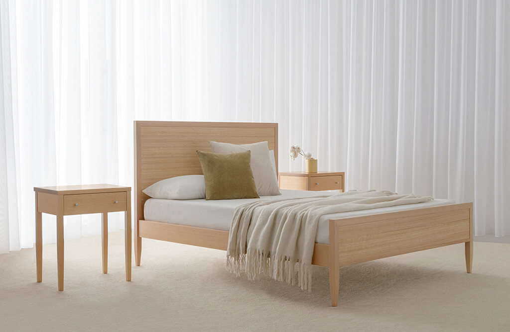 queen timber bed with higher headboard crafted in mountain ash timber with matching bedside tables