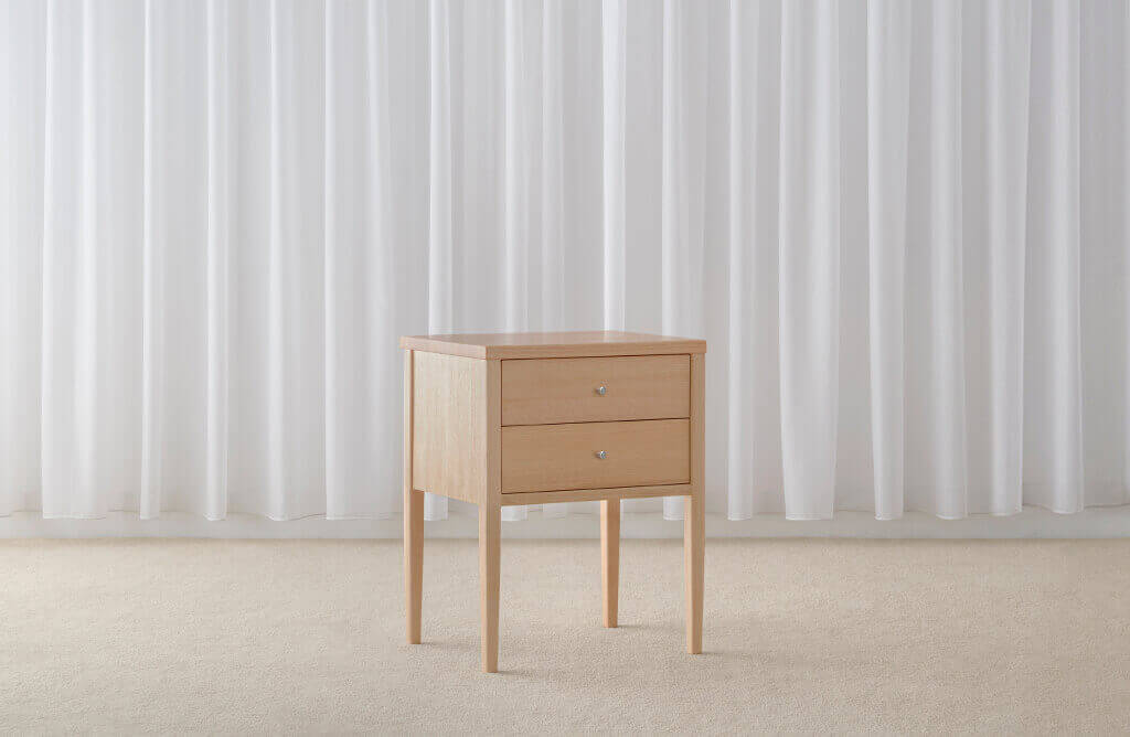2 drawer bedside table in mountain ash timber with slim legs and push to open drawers