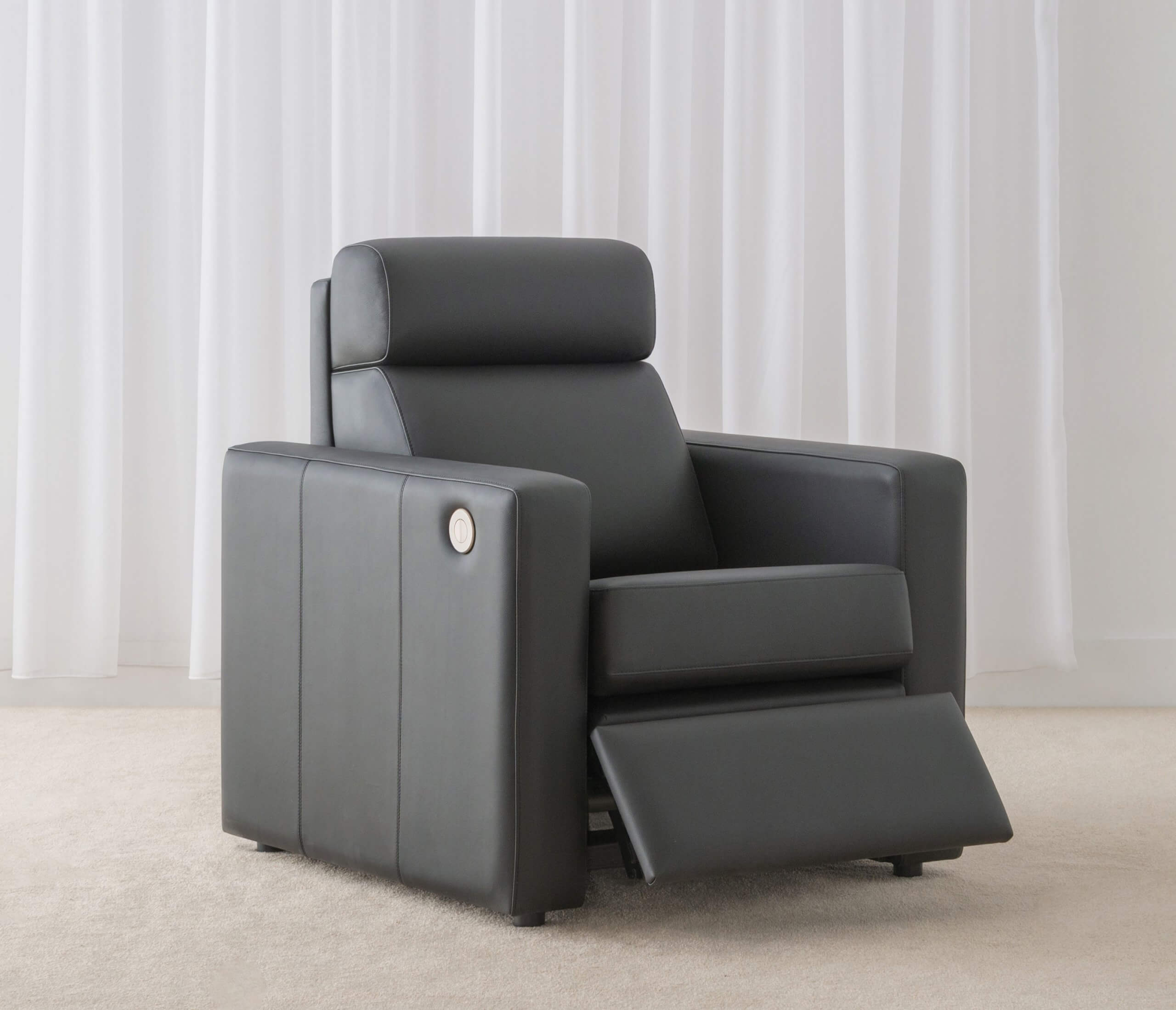black leather recliner chair with head roll and arm rests