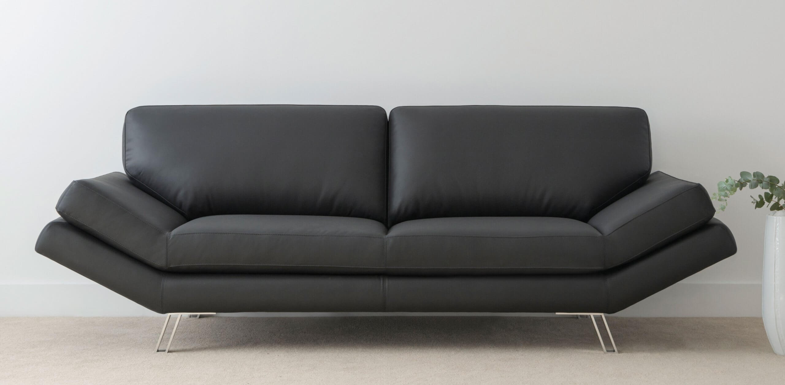 modern black leather lounge with chrome leg feature and angled arms