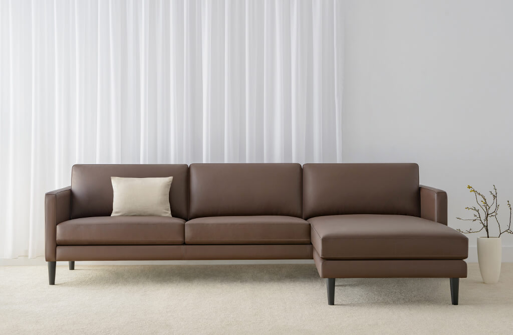 chocolate leather modular with chaise with timber legs and low back cushions for modern design