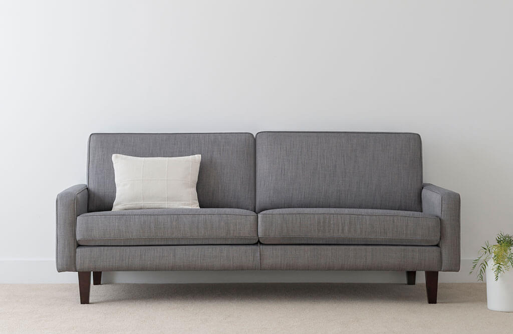 3 seater fabric lounge with blue grey fabric and squared cushions for modern design
