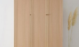 large free standing wardrobe with 3 doors and slim legs made from natural timber
