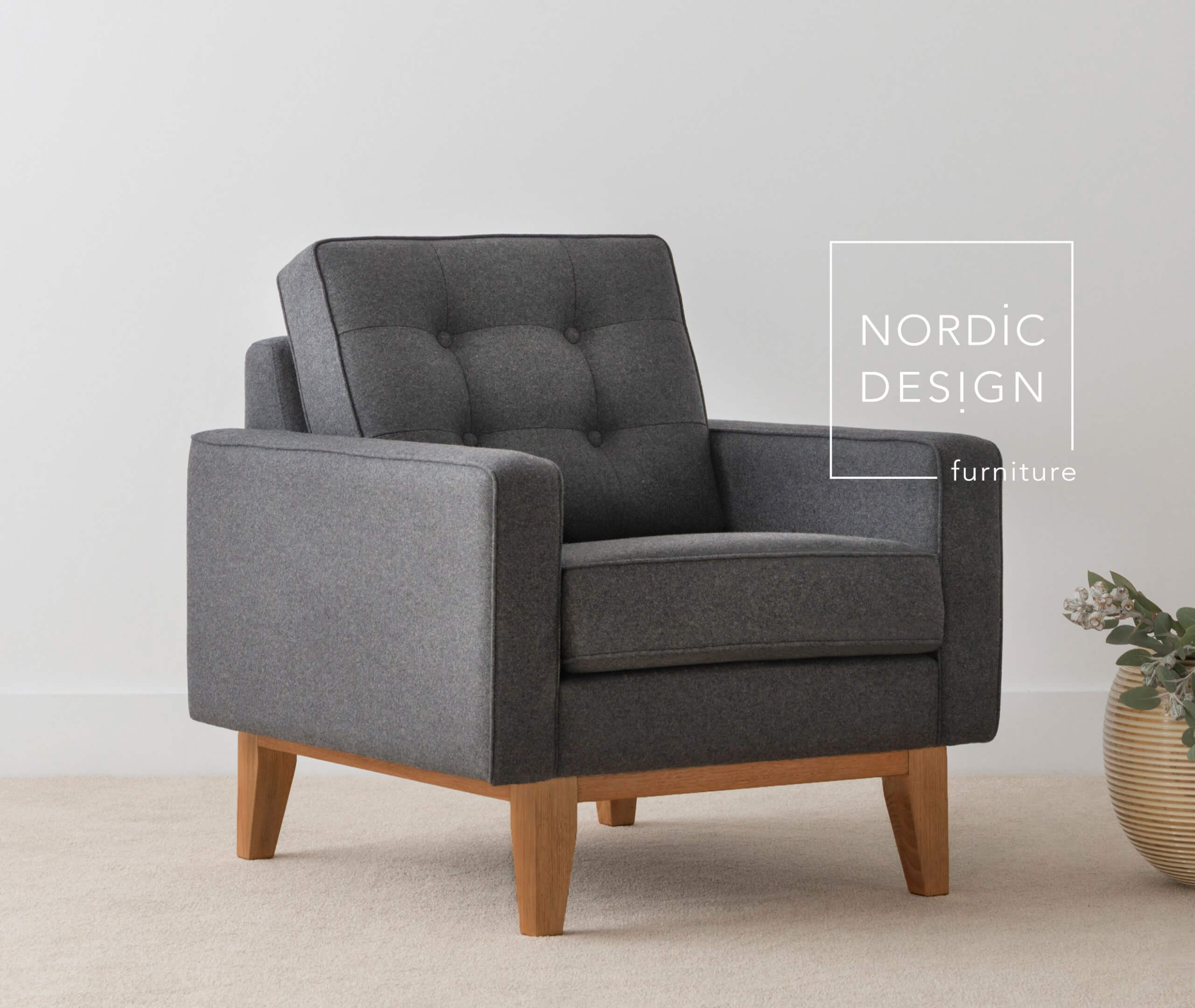 fabric arm chair with exposed blackwood timber base and button cushion detail