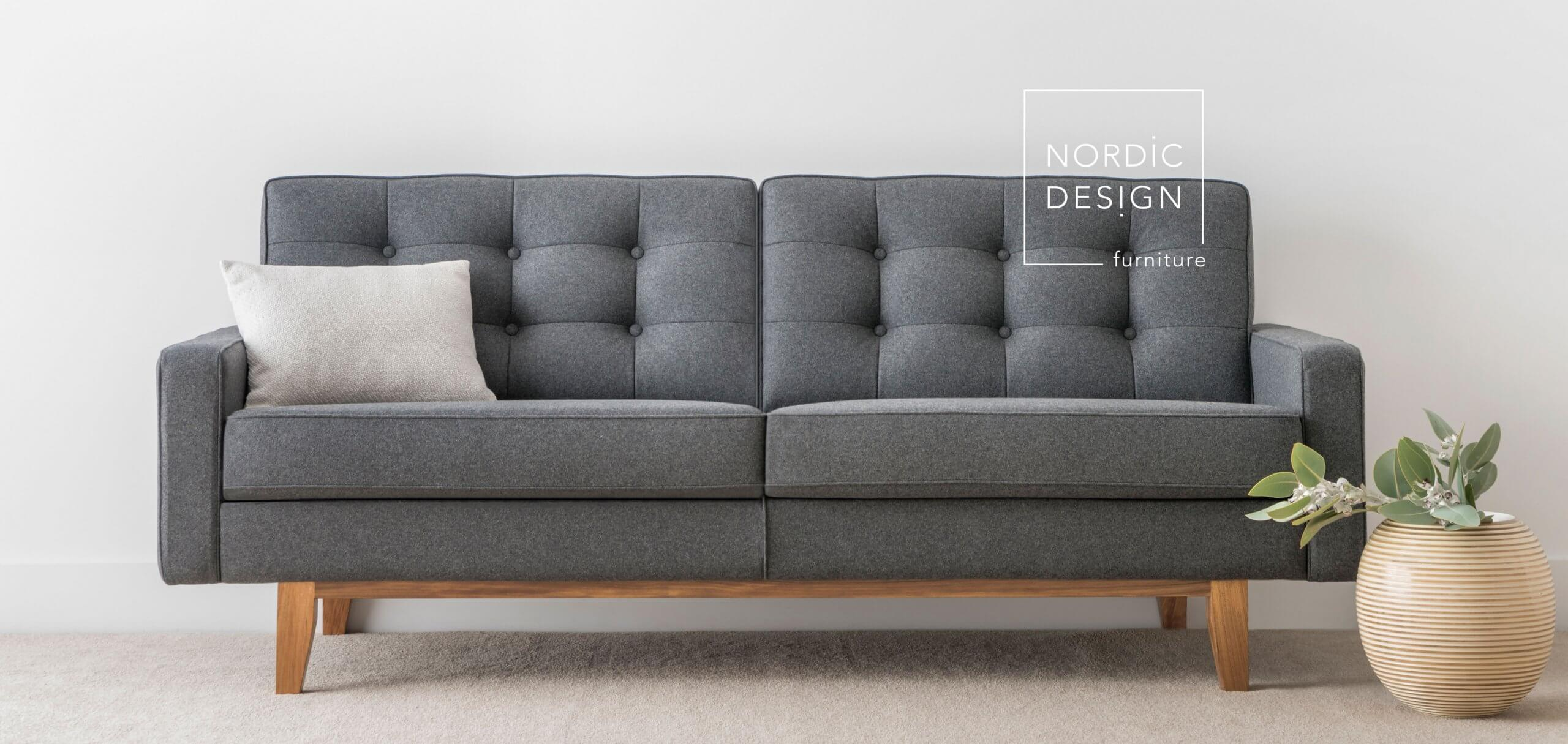 3 seater fabric sofa with button detail and timber legs