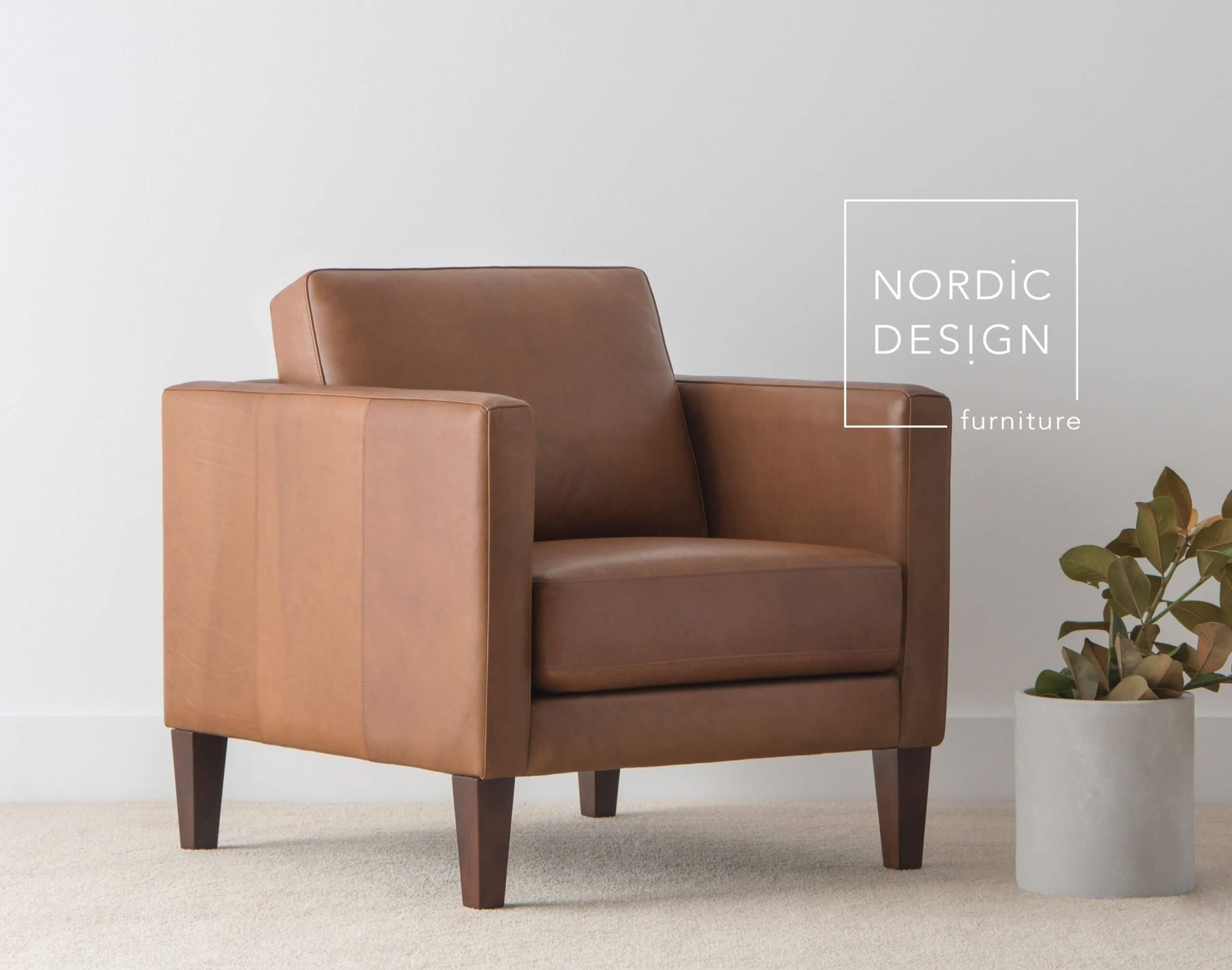 leather arm chair with thin arm rests and low back cushion with timber legs