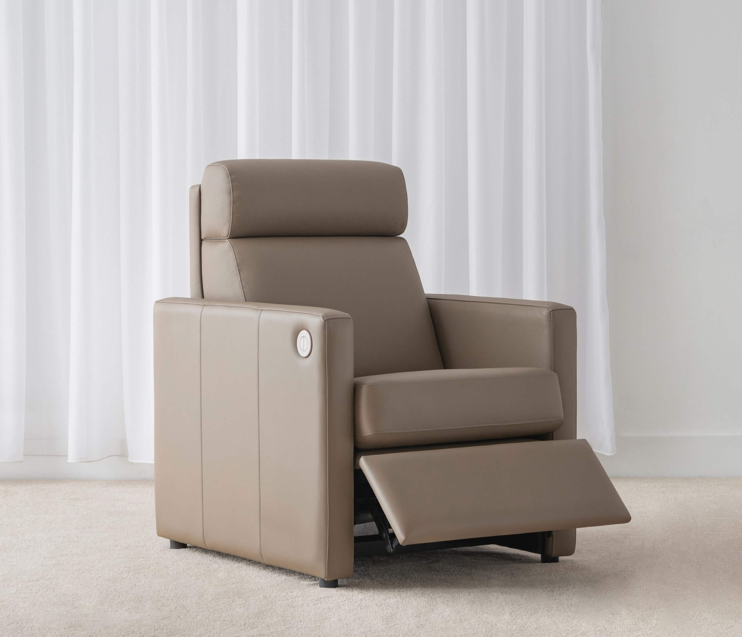 contemporary recliner chair with neutral leather and head roll