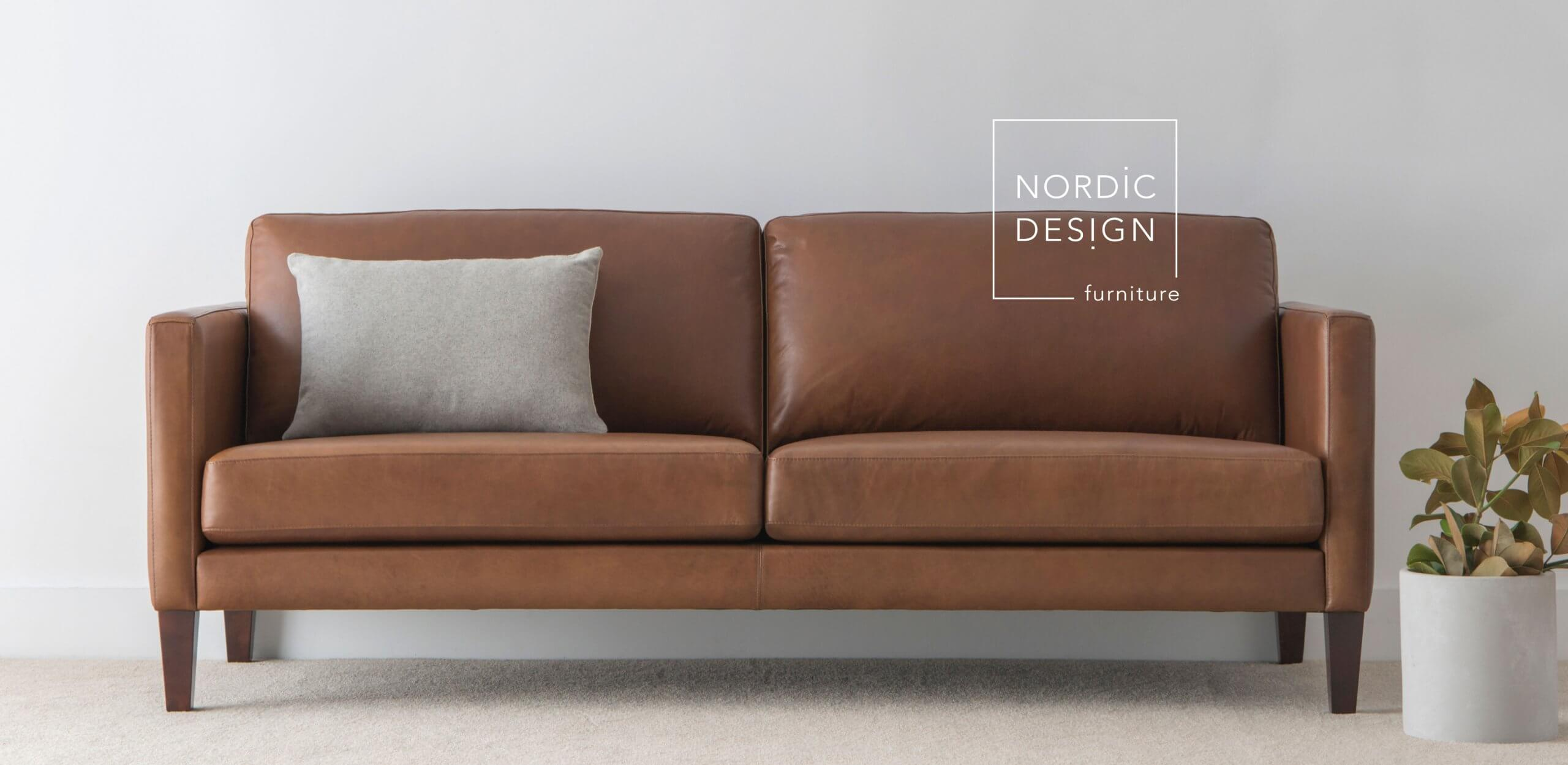 tan leather sofa made in Adelaide with exposed timber legs and slim arms