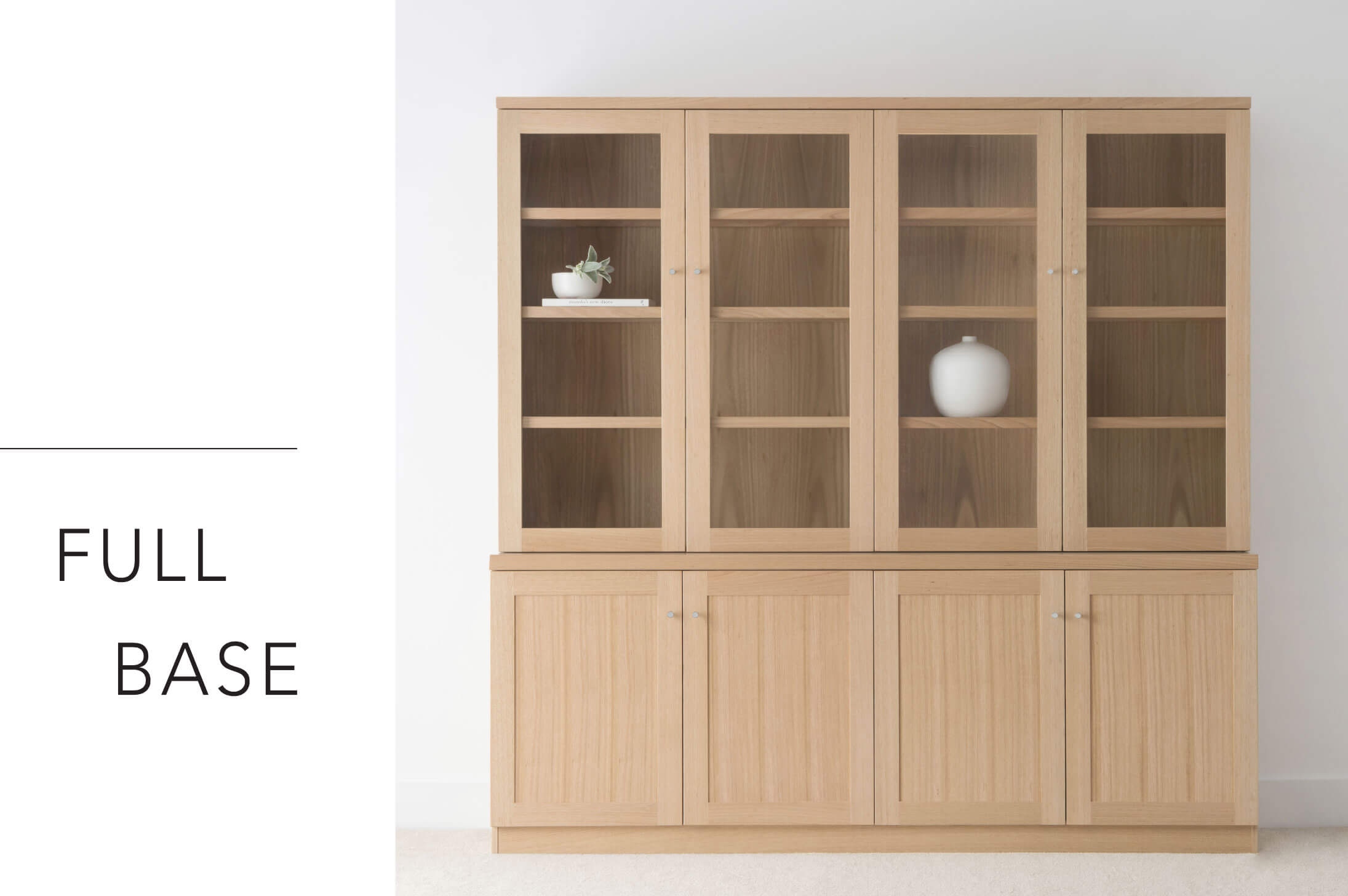 large timber wall unit made in oak with glass and timber doors and internal shelving