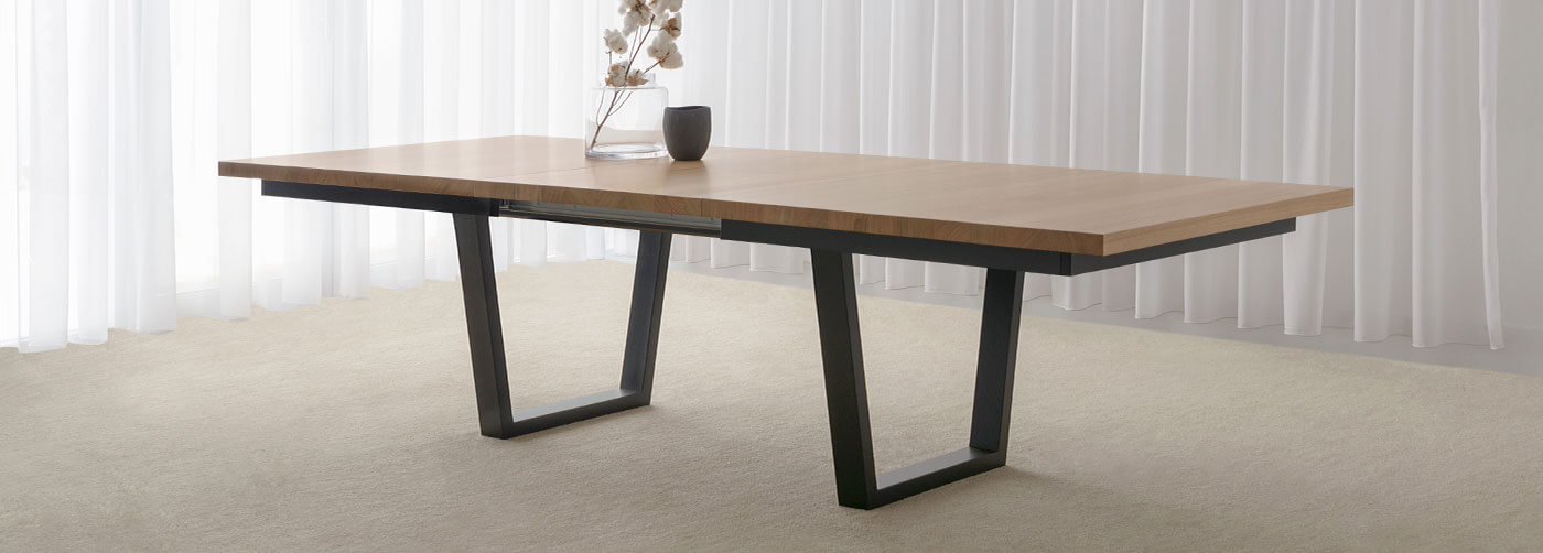 modern extendable dining table with mountain ash timber top and black trestle base