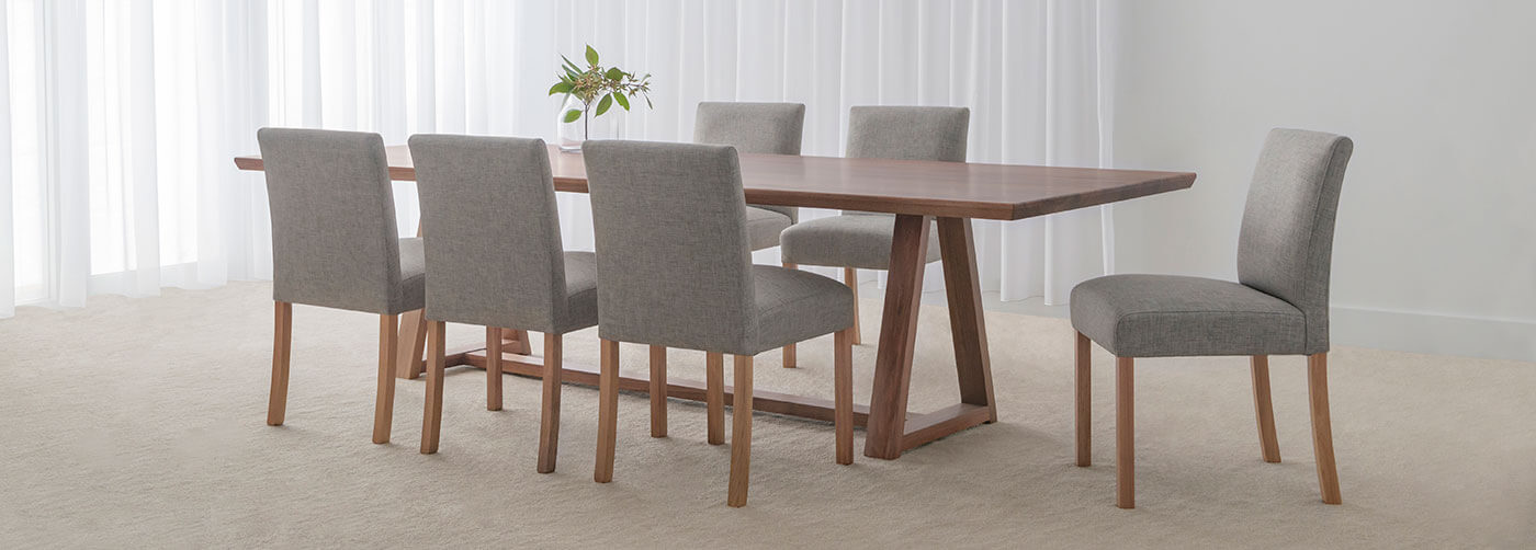 10 seater dining table with fabric dining chairs and blackwood timber trestle table