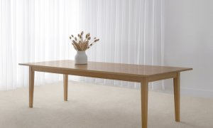 large oak dining table locally crafted from hardwood timber on four legs with beveled top