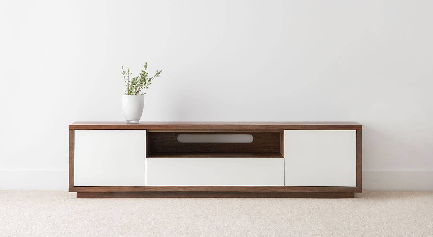 modern tv entertainment unit with blackwood timber border and white feature front